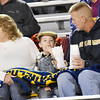 Nicholas County fans Kim, Lachlan, 3, and Donnie Crum, from Summersville, snack on popcorn before kickoff of their game against Midland Trail in Summersville. (Chris Jackson/The Register-Herald)