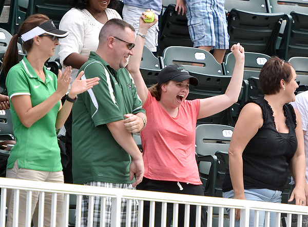 (Brad Davis/The Register-Herald) An excited fan catches an autographed ball at the Greenbrier Champions Tennis Classic Saturday afternoon in White Sulphur Springs.
