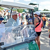 (Brad Davis/The Register-Herald) Governor and Greenbrier Resort owner Jim Justice mingles with fans as he makes his way around the grounds in his golf cart during second round Greenbrier Classic action Friday afternoon in White Sulphur Springs.
