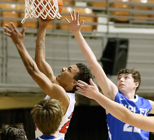 (Brad Davis/The Register-Herald) University's Storm Leftridge, left, drives and scores as Ripley's Eli Casto defends during Big Atlantic Classic action Friday afternoon at the Beckley-Raleigh County Convention Center.