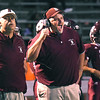 Dale Stafford, assistant coach, left, and head coach Chad Sarrett, of Woodrow Wilson, on the sideline during game against Bluefield Friday night at Van Meter Stadium in Beckley.<br /> (Rick Barbero/The Register-Herald)
