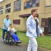 (Brad Davis/The Register-Herald) Hurricane residents and former students Don and Shelby Kincer, left, exit the still-used building that was once Stoco High School with Suffolk, Virginia resident and former student Gloria White at the conclusion of their annual reunion Saturday afternoon near Coal City.