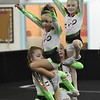 GymFinity All-Stars teams, Cosmo, are a traveling competitive cheerleading team coached by, Adam Holsten, tumbling instructor and head coach, Miranda Elkins, assistant cheer coach and Orlando Usan, gymnastics instructor and assistant cheer coach.<br /> (Rick Barbero/The Register-Herald)