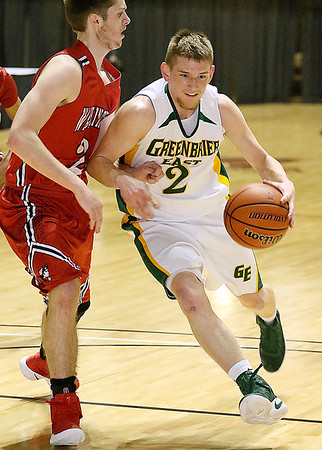 (Brad Davis/The Register-Herald) Greenbrier East's Seth Brown drives to the basket as Washington's Hunter Coates defends during Big Atlantic Classic action Friday night at the Beckley-Raleigh County Convention Center.