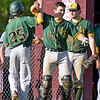 (Brad Davis/The Register-Herald) Greenbrier East's Mickey Kluska (#25) is congratulated by teammates Blake Colley (#10) and Daylon Colley after scoring a run during the Spartans' win over Woodrow Wilson Monday evening.
