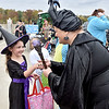 (Brad Davis/The Register-Herald) Young witch Lilly Haywood, 6, meets adult witch Cindy Worley during Tailgate Halloween Saturday afternoon atop Beckley's Intermodal Gateway.