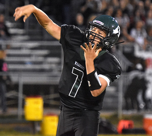(Brad Davis/The Register-Herald) Wyoming East quarterback Seth Ross throws Friday night in New Richmond.