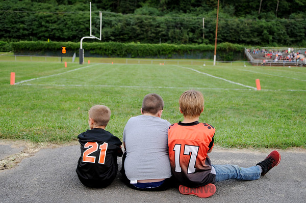 Three boys wait for the team t come out during Summers County's season opener against  PikeView  Friday in Hinton.  (Chris Jackson/The Register-Herald)