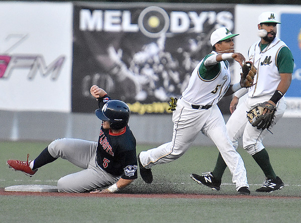 (Brad Davis/The Register-Herald) Miners shortstop Edwin Bonilla forces out Chillicothe's Dallas Hall for the first of a 6-4-3 double play Saturday night at Linda K. Epling Stadium.