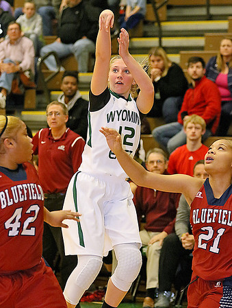 (Brad Davis/The Register-Herald) Wyoming East's Misa Quesenberry pulls up for a shot before Bluefield defenders Jamaikah Wallace, left, and Laamaj Wallace can get into position on her Wednesday night in New Richmond.