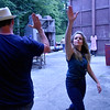 (Brad Davis/The Register-Herald) Actress Sierra Shreves high-fives art director Jason Adkins backstage following a scene from Theatre West Virginia's Footloose at Grandview Park's Cliffside Amphitheatre.
