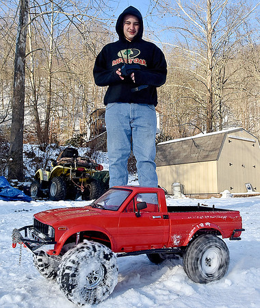 (Brad Davis/The Register-Herald) 14-year-old Joe Watson tears through the snow in a 1/10 scale, radio controlled pickup truck, one of several high performance R.C. cars that he owns Sunday afternoon at his Wyco Hollow Road home.