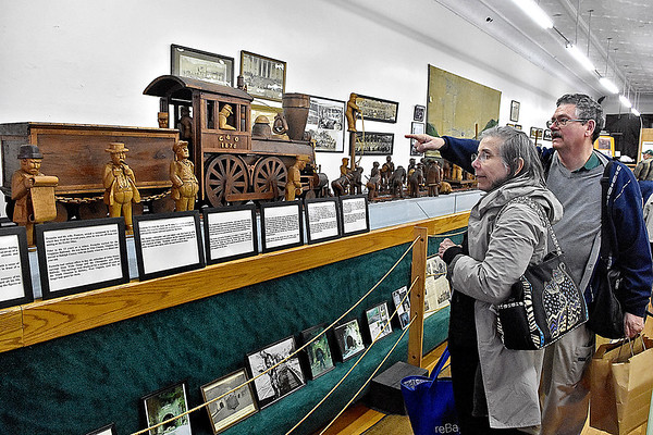 (Brad Davis/The Register-Herald) Charleston residents Jerry and Sherri Reveal, celebrating their 22nd anniversary at the event, check out some of the John Henry exhibits on hand at the Railroad Museum during Hinton Railroad Days Sunday afternoon.