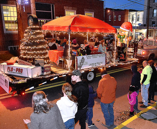 (Brad Davis/The Register-Herald) Floats decked out in seasonal theme roll along during Fayetteville's annual Christmas Parade Friday night.