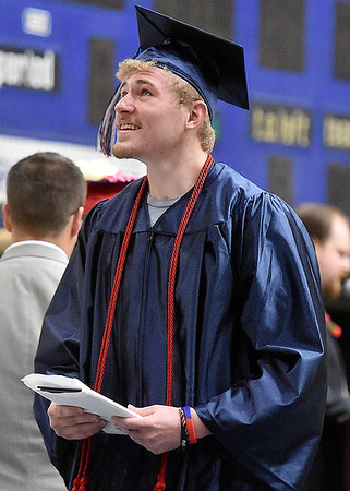 (Brad Davis/The Register-Herald) A graduating Independence senior reacts to cheers from family members sitting up in the stands during the school's 41st Commencement Saturday morning at the Beckley-Raleigh County Convention Center.