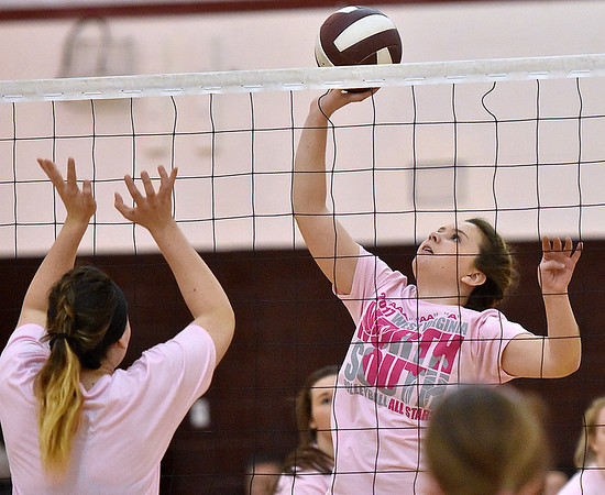 (Brad Davis/The Register-Herald) Split squads of Class AA (Pink) All-Stars play against each other during the West Virginia North/South All-Star Volleyball event Saturday afternoon at Woodrow Wilson High School.