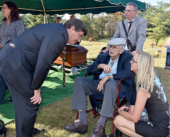 (Brad Davis/The Register-Herald) 92-year-old Truman Sayre converses with neice Frances Sayre and sons Tom Sayre, left, and Truman Sayre Jr. following the burial ceremony of his late brother Floyd, 88, a World War II veteran who fought in the Pacific theater, Saturday afternoon at Sunset Memorial Park.