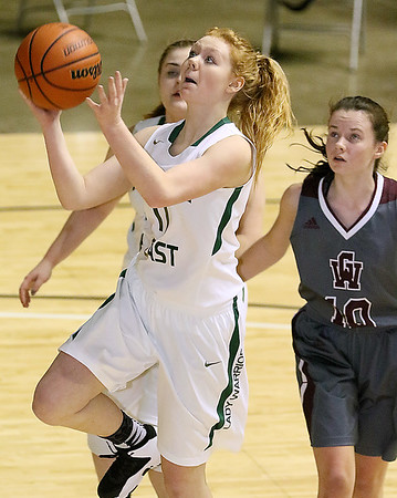(Brad Davis/The Register-Herald) Wyoming East Megan Davis drives and scores against George Washington during Big Atlantic Classic action Wednesday night at the Beckley-Raleigh County Convention Center.