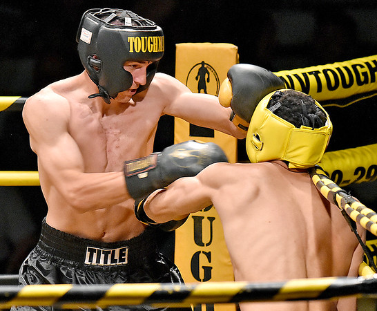 (Brad Davis/The Register-Herald) Defending champ Michael Suttle, left, takes on Antonio Weakley during the Original Toughman Contest Friday night at the Beckley-Raleigh County Convention Center. Suttle would win the fight.