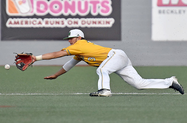 (Brad Davis/The Register-Herald) A sharp Chillicothe hit up the middle, one of 18 on the day, just gets past diving Miners 2nd baseman Brent Todys during a loss to the Paints Sunday afternoon at Linda K. Epling Stadium.