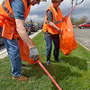 (Brad Davis/The Register-Herald) Volunteer Marcia Dunlap and her husband Ken work their way along Harper Road looking for cigarette butts and other smaller, harder to see items of garbage during Raleigh County Make-It-Shine's Spring litter sweep Friday afternoon.