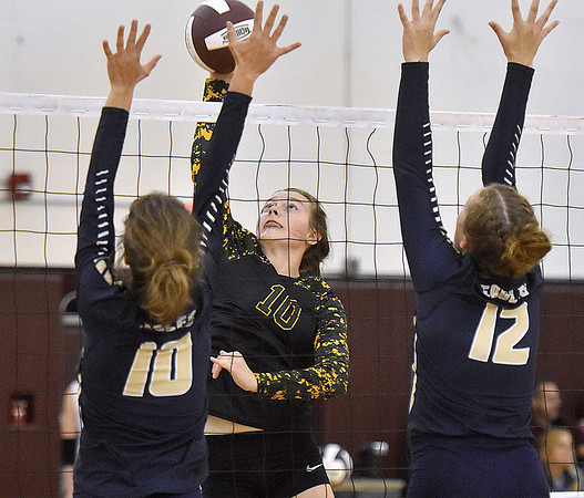 (Brad Davis/The Register-Herald) Greenbrier East's Karlei Shaver tries to blast a spike between Hedgesville's Kelsey Turben, right, and Madelynn Butler during the Shirley Brown Invitational Volleyball Tournament Saturday afternoon at Woodrow Wilson High School.