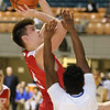 (Brad Davis/The Register-Herald) Parkersburg's Parker Miller drives and scores as Morgantown's Jayron Wilson defends during Big Atlantic Classic action Friday night at the Beckley-Raleigh County Convention Center.