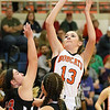 (Brad Davis/The Register-Herald) Summers County's Hannah Taylor pulls up for a short-range shot as Chapmanville's Madison Ward (#13) and Kaylee Blair (#24) defend during the Lady Bobcats' win over the Tigers Saturday night in Hinton.