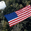 (Brad Davis/The Register-Herald) Skydiver John Garrido brings the Stars & Stripes in for what would be a perfect landing during Bridge Day Saturday afternoon.
