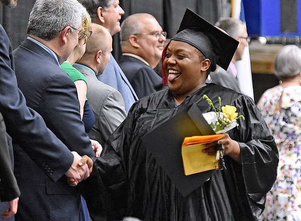 (Brad Davis/The Register-Herald) Graduate Shawna Allen reacts as she shakes hands with school and county officials after collecting her certificate in phlebotomy during the Academy of Careers and Technology's 2017 Awards ceremony Thursday night at the Beckley-Raleigh County Convention Center.