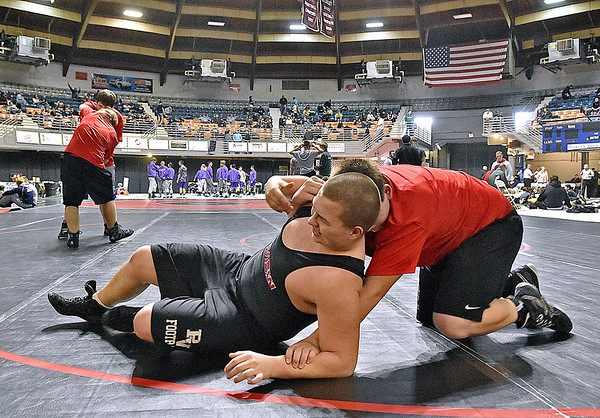 (Brad Davis/The Register-Herald) PikeView wrestlers Ronald Helsel, left, and teammate Tyler Tiller iron out their techniques as they and Panther teammates warm up prior to the start of the 36-team West Virginia National Guard Duals Friday afternoon at the Beckley-Raleigh County Convention Center.