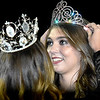 (Brad Davis/The Register-Herald) New Indy Homecoming Queen Madison Testement is crowned by last year's queen Brooke Bowers during halftime Friday night in Coal City.