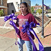 (Brad Davis/The Register-Herald) Women's Resource Center volunteer and Concord University professor Lori Pace carries purple ribbons to be hung around town for domestic violence awareness month Sunday afternoon in uptown Beckley. Bessie's Floral Designs in Oak Hill and Flowers by Nancy in Beckley donated the ribbons and materials to the Women's Resource Center.