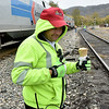 (Brad Davis/The Register-Herald) It's never too cold for an ice cream cone if you ask New River Train EMT Dave Tucker, who enjoys one during a break in the ride during a chilly Hinton Railroad Days Sunday afternoon.