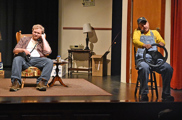 (Brad Davis/The Register-Herald) One of many phone conversations between Jim Cunningham and his friend Larry (right), played by Gerald Hayden, during a scene from FRACK! Saturday night at The Raleigh Playhouse & Theatre.