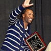 (Brad Davis/The Register-Herald) Arizona Cardinals receiver Larry Fitzgerald waves and thanks the crowd following a speech as the keynote speaker of the Big Atlantic Classic Tip-Off Banquet Sunday afternoon at the Beckley-Raleigh County Convention Center.
