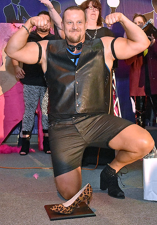 (Brad Davis/The Register-Herald) Marty Helmandollar at the conclusion of the annual Hunks in Heels fundraising event for the Women's Resource Center Friday night at the Beckley Moose Lodge.