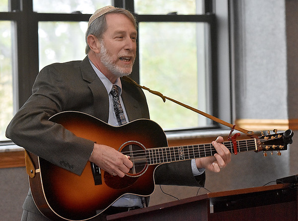 (Brad Davis/The Register-Herald) Rabbi David Sofian plays a special memorial song during the opening moments of Yom HaShoah, or Holocaust Remembrance Day, Sunday afternoon inside WVU Tech's Carter Hall.