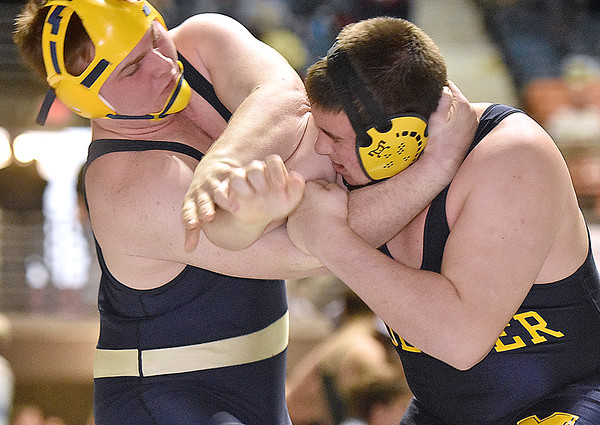 (Brad Davis/The Register-Herald) Greenbrier West's Trevor Brown, left, takes on Moeller's Andrew Yeager in a 285-pound weight class matchup during the West Virginia Army National Guard Duals Friday afternoon at the Beckley-Raleigh County Convention Center. Moeller's Yeager would pin Brown to win the match.