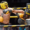 (Brad Davis/The Register-Herald) Sophia's Brandon Wood, left, lands a left on Beckley's Clifford Jennings during Original Toughman action Saturday night at the Beckley-Raleigh County Convention Center. Wood would win the fight.