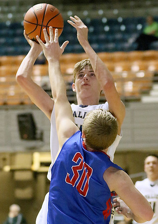 (Brad Davis/The Register-Herald) Greenbrier West's Collin O'Dell shoots as Midland Trail's Matt Scaggs defends during Big Atlantic Classic action Wednesday afternoon at the Beckley-Raleigh County Convention Center.