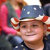 "Aaron Spence, second grader, listens to the first grade class sing, ""My Country Tis of Thee"" during a Vereran's Day program held at Lester Elementary School Wednesday afternoon.<br /> (Rick Barbero/The Register-Herald"