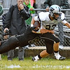 (Brad Davis/The Register-Herald) Westside's Brock Smith carries the ball as Wyoming East's Clay Lester tries to bring him down Friday night in New Richmond.