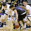 (Brad Davis/The Register-Herald) James Monroe's Darian Munsey is pressured by Shady Spring defenders Cole Honaker, right, and Ryan Riffe Wednesday night at Shady Spring Middle School.