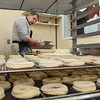 Paul Plumley working dough at the Donut Connection.<br /> (Rick Barbero/The Register-Herald