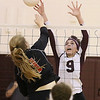 (Brad Davis/The Register-Herald) Woodrow Wilson's Sydney McClung tries to block a kill attempt by St. Albans' Katelyn McVicker Saturday afternoon at Woodrow Wilson High School.