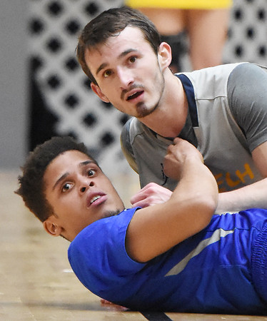 WVU Tech's Cole Schoolcraft and Ohio Christian's Troy Mundy wait for an officials call on a play during the first half of their college basketball game against Ohio Christian in Beckley on Tuesday. (Chris Jackson/The Register-Herald)
