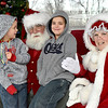 "(Brad Davis/The Register-Herald) Twin bothers Lucas, left, and Lennox Accord, 6, convey their Christmas wishes to Santa and Mrs. Claus during the 4th annual "" Santa at the Lighthouse"" event Saturday evening on the grounds of the Summersville Lake Retreat. This year the sponsored school was Zela Elementary, where students in grades K-2nd were invited to meet Santa and Mrs. Claus, have some hot chocolate and receive bundles of gifts they otherwise wouldn't be able to enjoy."