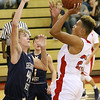 (Brad Davis/The Register-Herald) Independence's Niko Burgess drives to the basket as Greenbrier West's Collin O'Dell steps up to defend Friday night in Coal City.