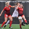 (Brad Davis/The Register-Herald) University forward Ariana Christiansen's (middle) attack is roughly fended off by Cabell Midland's Aubrey Howard-Brown, left, and Gabby Hammers during the Class AAA Girls State Soccer Championship Game Saturday afternoon at the YMCA Paul Cline Memorial Sports Complex.